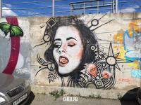 Граффити девушка высунула язык