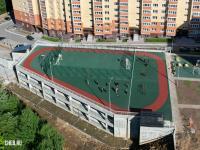 Двухуровневая парковка со спортивной площадкой на крыше